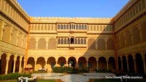 Central courtyard & musician at Suryagarh Jaisalmer