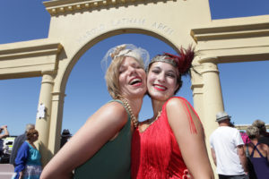 Smiling ladies in front of Arch