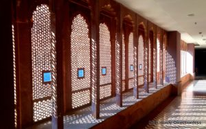 Curved arches and intricate jaalis along the corridors at Narendra Bhawan