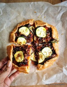 Caramelised onion & zucchini galette, sliced