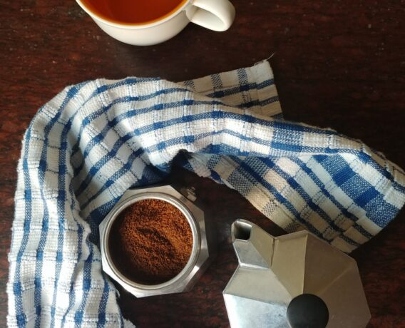 Moka pot with coffee and cup