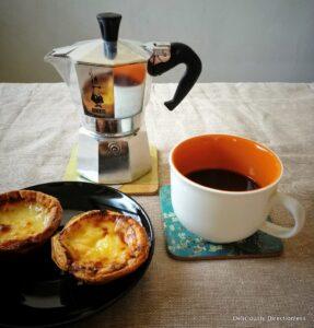 Moka Pot with coffee cup and pasteis de nata